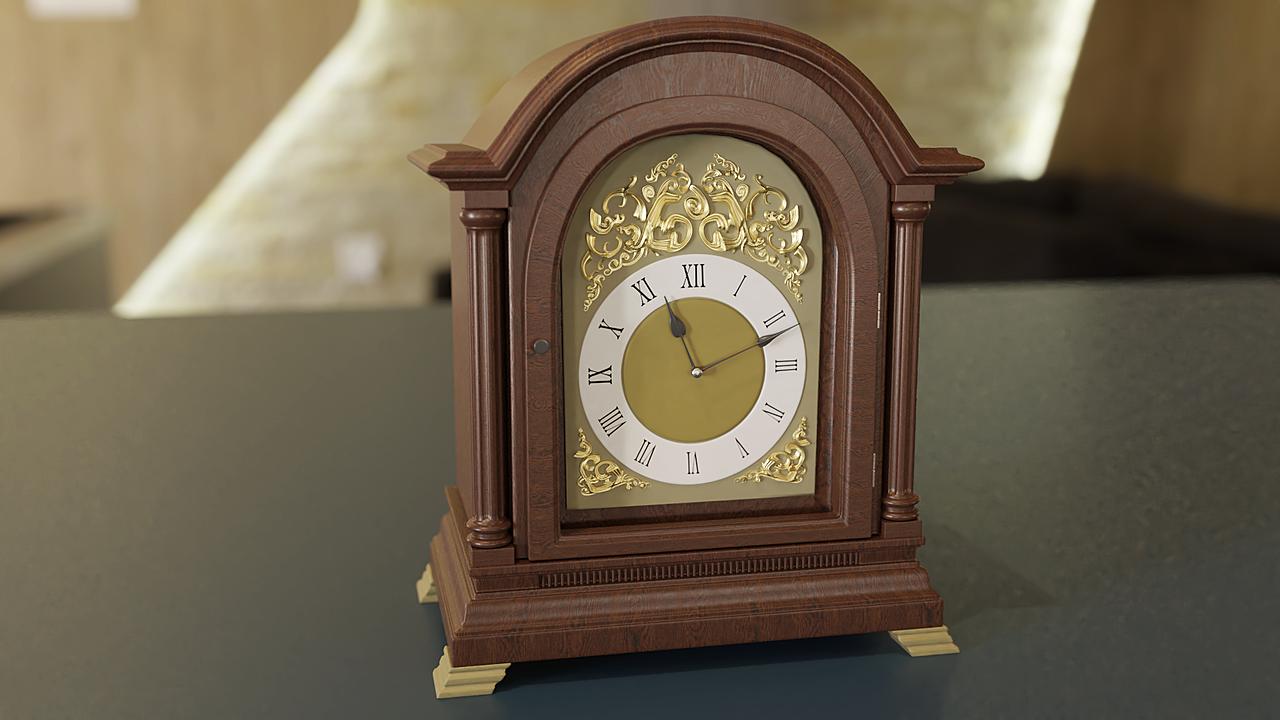 An Edwardian Georgian style cased mantel clock